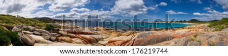 bicheno beach in tasmania australia with beautiful blue water - stock photo