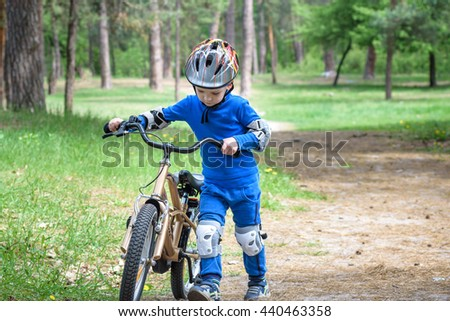 Bicycle accident. Kids safety concept. Boy transporting his bike to repair place. - stock photo