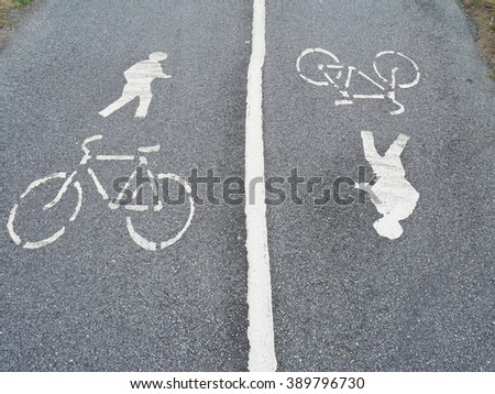 Bicycle and walking signs on street