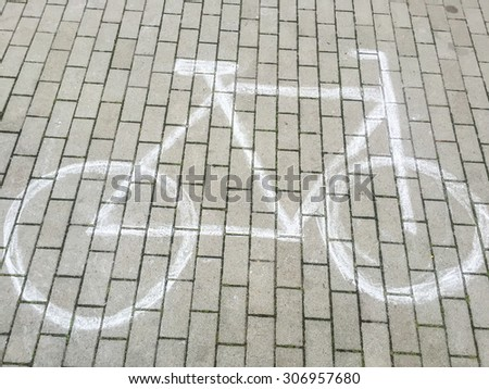Bicycle chalk drawing on a pavement. - stock photo