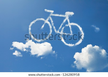 Bicycle cloud shape form floating on blue sky - stock photo