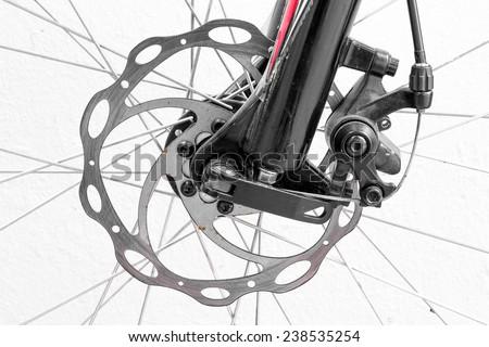 Bicycle disc brake on white background. - stock photo