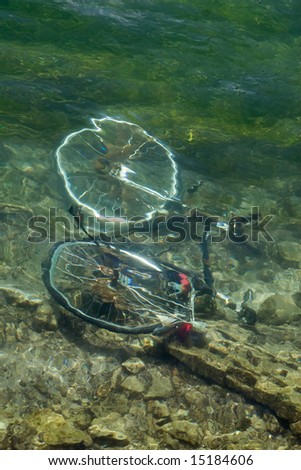 Bicycle drown in water of lake of Zurich - stock photo