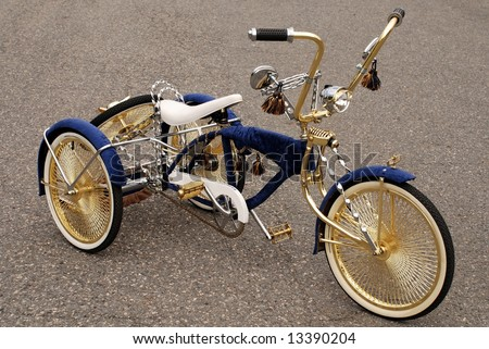 Bicycle has three wheels modified with gold and silver - stock photo