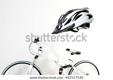Bicycle helmets with bikes in the background.