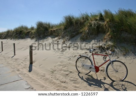 Bicycle in the sand - stock photo