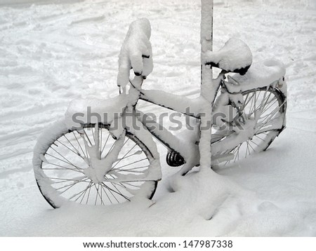 Bicycle in the snow - stock photo