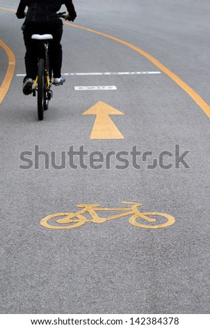 Bicycle lane in public park - stock photo
