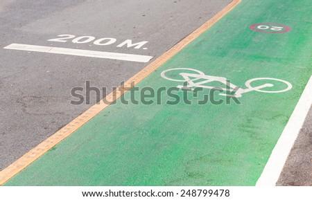 Bicycle lane near the running lane of urban park. - stock photo