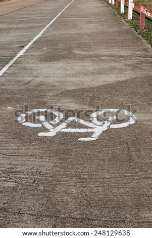 bicycle lane sign painted on the asphalt paint