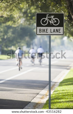 Bicycle Lane signboard at the roadside - stock photo