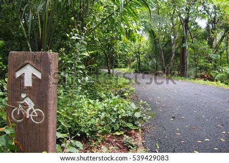 Bicycle lane with sign in the park.