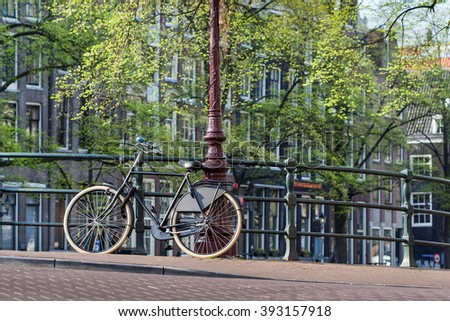 bicycle locked on top of bridge in Amsterdam, Holland