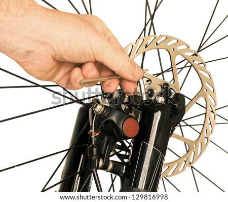 Bicycle Maintenance- Repairing the Disc Brakes on a Mountain Bike - stock photo