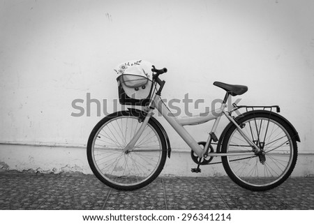 bicycle on black and white  old  house wall.
