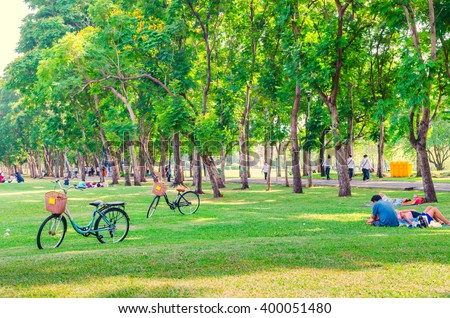 Bicycle on green grass in the park - stock photo