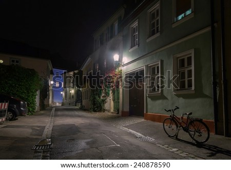 Bicycle on the night european city street in Germany  - stock photo