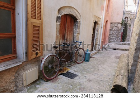 Bicycle on the old street in the village Coaraze, France - stock photo