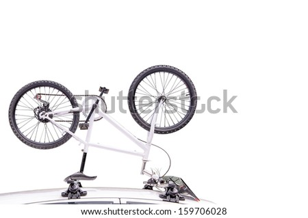 Bicycle on the roof of the car. isolated on white - stock photo