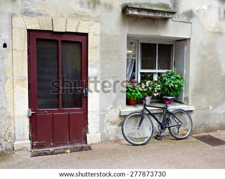 Bicycle on the street in small village Villes-sur-Auzon.  Provence, France.  - stock photo