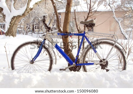 bicycle on the street in winter - stock photo