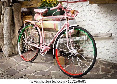 bicycle painted in pink for the Tour of Italy