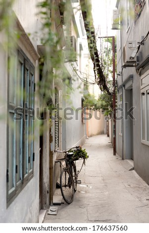 Bicycle parked in a Hanoi alleyway - stock photo