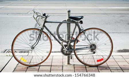 Bicycle parked on the street in Toronto - stock photo