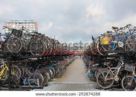 Bicycle parking in the center of Amsterdam. - stock photo