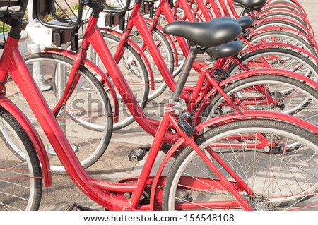 Bicycle parking - row of bicycles in the campus - stock photo