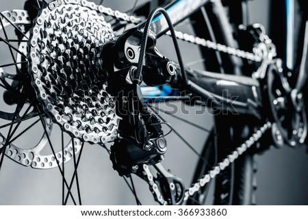 bicycle parts rear wheel brake disc cassette fragment frame - stock photo