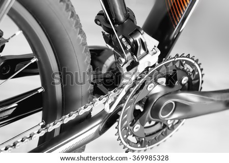 bicycle parts rear wheel brake disc frame cassettes chain fragment - stock photo