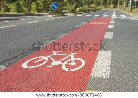 Bicycle path drawn on the asphalt road. Lanes for cyclists. Traffic signs and road safety. Cycleway in Brno, Czech Republic. - stock photo