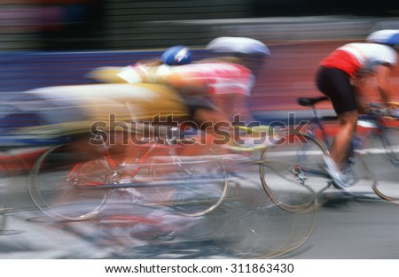 Bicycle racers speeding past in Subaru Bicycle Race, Beverly Hills, California - stock photo