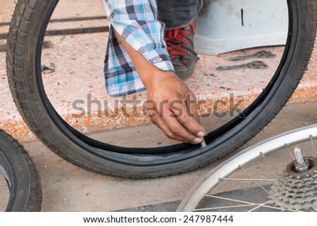 Bicycle repair. Repairing or changing a tire or wheel - stock photo