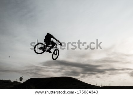 Bicycle Rider Jumping through the air - stock photo