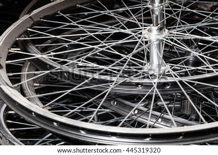 Bicycle rim in workshop. Wheel manufacturing in black background - stock photo