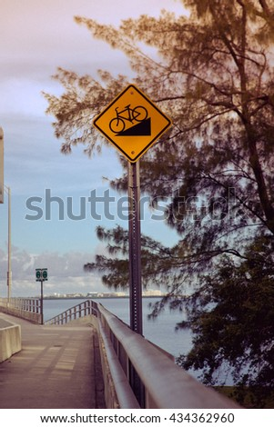 Bicycle road incline signage on street for special bicycle road on Rickenbacker causeway for Key Biscayne. Near the ocean and Virginia Key. Miami. Florida. USA - stock photo