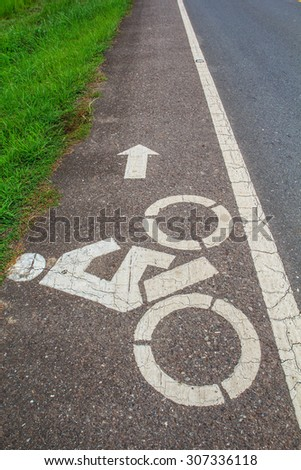 Bicycle road sign and arrow. - stock photo