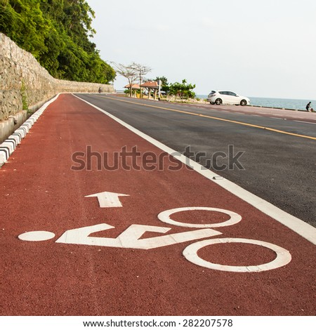 Bicycle road sign and arrow in outdoors - stock photo