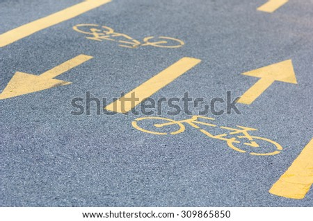 Bicycle road sign on asphalt. - stock photo