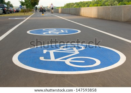 Bicycle road sign on asphalt. Leisure activities - stock photo