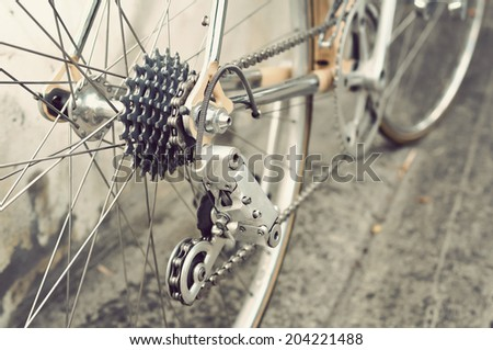 Bicycle's detail view of rear wheel with chain & sprocket - stock photo