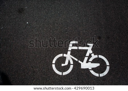 Bicycle sign. Bicycle Lane. Bicycle lane signage on street. Bicycle sign path on road, bikes' lane on outskirts or urban area. Bicycle lane signage on street.