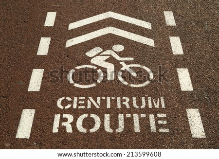 Bicycle sign for the city center on a red bicycle lane. - stock photo