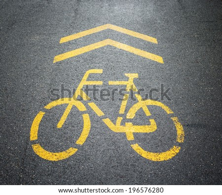 Bicycle sign painted on the road. - stock photo