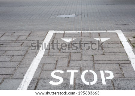 Bicycle signs on the street surface, stop line
