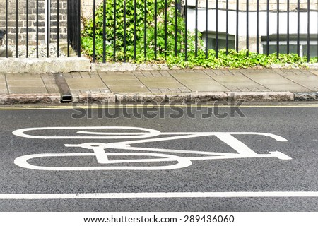 Bicycle stop lane at traffic light, UK - stock photo