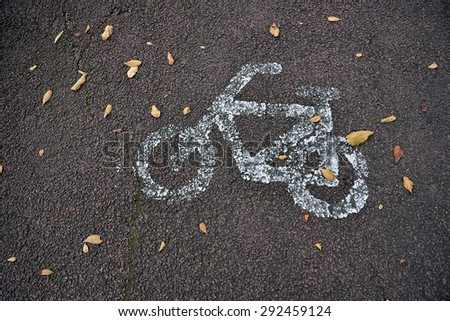 Bicycle symbol on city street. Bike sign on the road. - stock photo