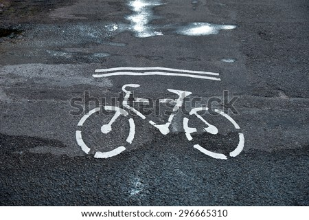 Bicycle symbol on city street. Bike sign on the road. Bike lane. - stock photo